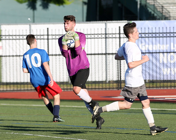 Staff photo/ HADLEY GREEN<br /> South's Nick Capra of Salem makes a save during the Agganis boys soccer all-star game.<br /> <br /> 06/26/2018