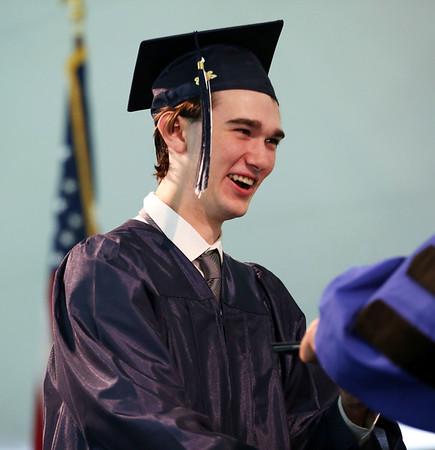 Staff photo/ HADLEY GREEN<br /> Austin Manning walks across the stage at the Hamilton-Wenham Regional High School graduation ceremony. <br /> <br /> 06/01/2018