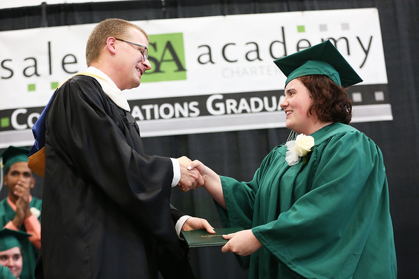 Staff photo/ HADLEY GREEN Katherine Darmody receives her diploma at the Salem Academy Charter School graduation ceremony at the Read Gymnasium in Salem.  06/15/2018