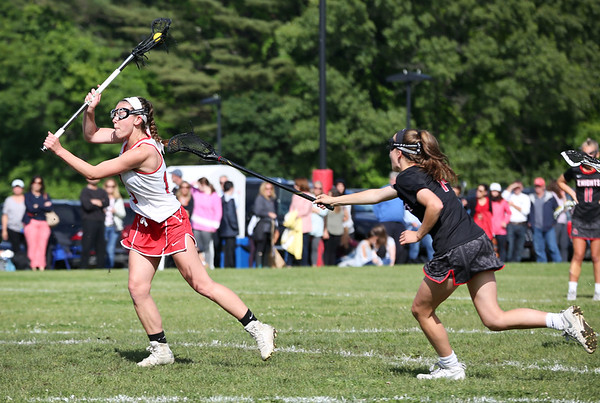 Staff photo/ HADLEY GREEN<br /> Masconomet's Jordyn Tveter (15) shoots while North Andover's Ainsley Dion (14) plays defense.<br /> <br /> 06/05/2018