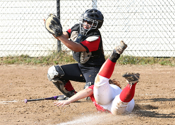 Staff photo/ HADLEY GREEN<br /> Catcher Jolie Quintana (30) looks for the ball at home plate while a Melrose player dives in to score. <br /> <br /> 06/08/2018