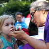 Staff photo/ HADLEY GREEN<br /> Marcella Guerrieo of Peabody paints a unicorn on Robin Sayer's face, also of Peabody, during the city's Pop Up Market on the Leather City Common. <br /> <br /> 06/12/2018