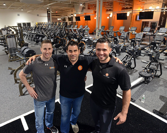 RYAN HUTTON/ Staff photo<br /> Best Fitness CEO David Dos Santos, center, stands with his partners Andy Marino, left, and Jor Dimare, right, in the company's newest location at the Liberty Tree Mall in Danvers on Thursday.