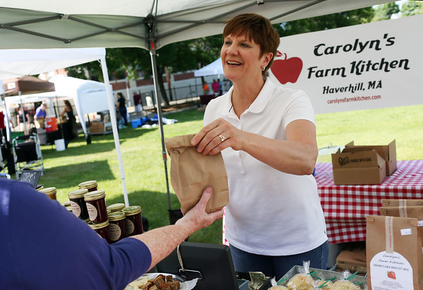 Staff photo/ HADLEY GREEN<br /> Carolyn Grieco of Carolyn's Farm Kitchen serves a customer at Peabody's Pop Up Market on the Leather City Common. <br /> <br /> 06/12/2018