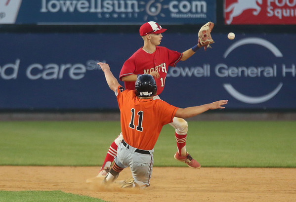 Staff photo/ HADLEY GREEN<br /> Beverly's Matt Collins (11) slides into second base while North Attleborough's Todd Robinson (2) catches the ball to make the winning out during the Division 2 state championship at LeLacheur Park in Lowell.<br /> <br /> 06/21/2018
