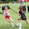 Staff photo/ HADLEY GREEN<br /> Masconomet's Liz Evans (18) shoots while North Andover's Cate Cheevers (2) plays defense.<br /> <br /> 06/05/2018