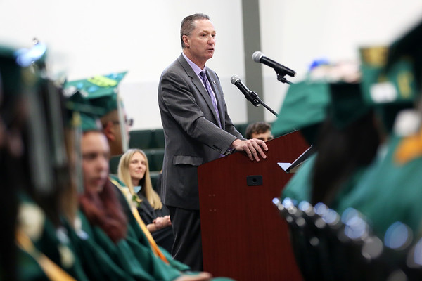 Staff photo/ HADLEY GREEN<br /> Rep. Paul Tucker congratulates students at the Salem Academy Charter School graduation ceremony.<br /> <br /> 06/15/2018