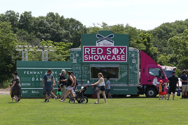 HADLEY GREEN/Staff photo<br /> The Red Sox Showcase, an interactive baseball experience with games and family fun, came to Plains Park in Danvers.<br /> <br /> 06/30/2018