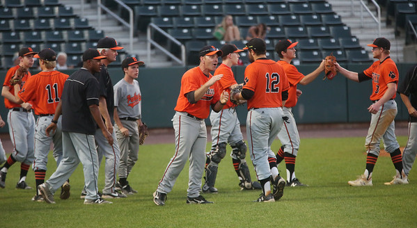 Staff photo/ HADLEY GREEN<br /> After scoring three runs, Beverly players celebrate during the Division 2 state championship game at LeLacheur Park in Lowell.<br /> <br /> 06/21/2018