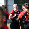 Staff photo/ HADLEY GREEN<br /> Marblehead players congratulate pitcher Charlotte Plakans after a strong inning. <br /> <br /> 06/08/2018