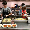 Staff photo/ HADLEY GREEN<br /> Students plate pasta in the kitchen at Swampscott Middle School's charity dinner to support Feeding America. <br /> <br /> 06/12/2018
