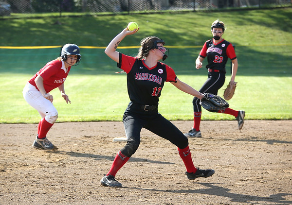 Staff photo/ HADLEY GREEN<br /> Marblehead's Mercedes Pelletier fields the ball and throws to first. <br /> <br /> 06/08/2018