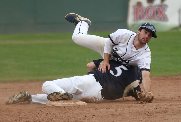 Staff photo/ HADLEY GREEN<br /> Hamilton-Wenham's Jake Lanciani (3) leaps over Archbishop Williams' David Ryan (5) as Lanciani tries to make an out at second base during the Division 4 state semifinal match at Campanelli Stadium in Brockton.<br /> <br /> 06/20/2018