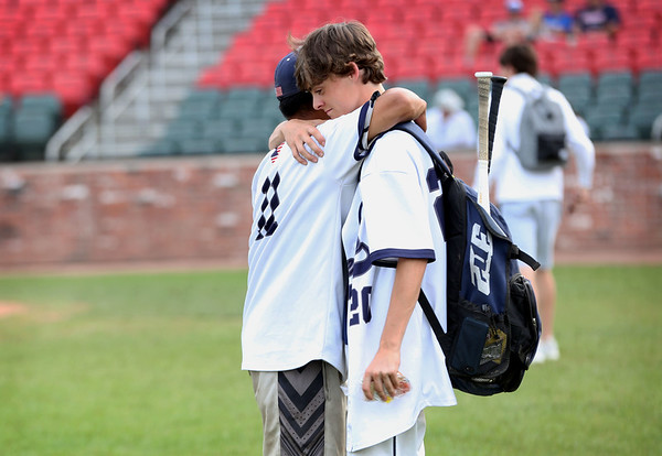 Staff photo/ HADLEY GREEN<br /> Hamilton-Wenham teammates Adam Parady (11) and Lenny Dolan (20) embrace after losing to Archbishop Williams in the Division 4 baseball state semifinals at Campanelli Stadium in Brockton.<br /> <br /> 06/20/2018