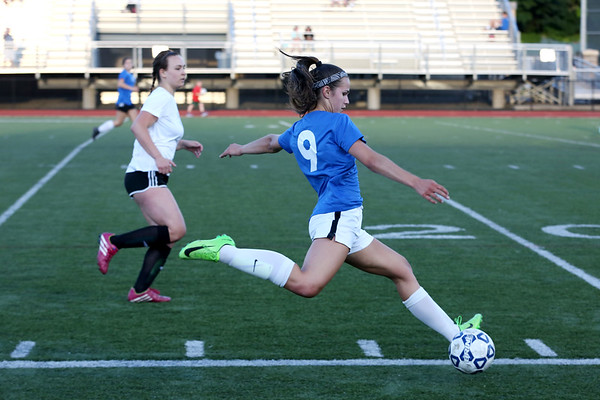 Staff photo/ HADLEY GREEN<br /> Beverly's Stephanie MacLeod (9) runs with the ball while playing for the north team at the Agganis girls soccer all-star game.<br /> <br /> 06/26/2018