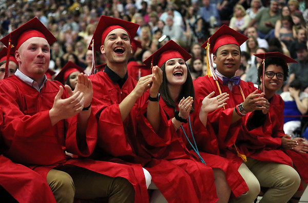 Staff photo/ HADLEY GREEN<br /> Students applaud as their peers walk across the stage at the Salem High School graduation ceremony. <br /> <br /> 06/01/2018