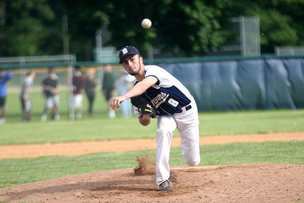 Staff photo/ HADLEY GREEN<br /> Danvers' Justin Nadeau (8) pitches. <br /> <br /> 06/07/2018