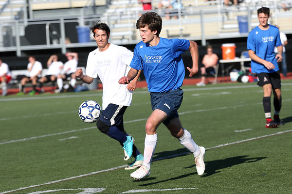Staff photo/ HADLEY GREEN<br /> North's Ross Lojek (19) of Triton runs towards the ball at the Agganis boys soccer all-star game.<br /> <br /> 06/26/2018