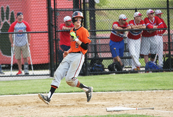 Staff photo/ HADLEY GREEN<br /> Beverly's (9) looks to the ball as he runs through home plate. <br /> <br /> 06/07/2018