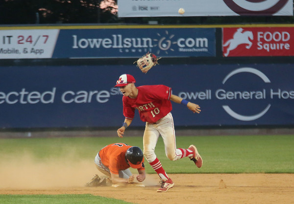 Staff photo/ HADLEY GREEN<br /> North Attleborough's Todd Robinson (2) celebrates after tagging Beverly's Matt Collins (11) in the final out at second base during the Division 2 state championship at LeLacheur Park in Lowell.<br /> <br /> 06/21/2018