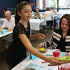Staff photo/ HADLEY GREEN<br /> Student Sophia Ciciotti serves salad to her table at Swampscott Middle School's charity dinner to support Feeding America. <br /> <br /> 06/12/2018