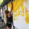 Staff photo/ HADLEY GREEN<br /> Artist Mariah Leah paints a mural at the Salem Arts Festival. <br /> <br /> 06/01/2018