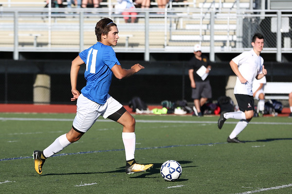 Staff photo/ HADLEY GREEN<br /> North's Alex Renaud (11) of Hamilton-Wenham moves the ball at the Agganis boys soccer all-star game.<br /> <br /> 06/26/2018