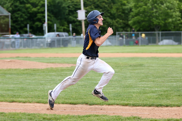 Staff photo/ HADLEY GREEN<br /> St. Mary's Colin Reddy (6) sprints to first base after hitting.<br /> <br /> 06/07/2018