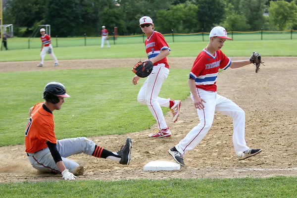 Staff photo/ HADLEY GREEN<br /> Beverly's (10) slides safely into first base after hitting.<br /> <br /> 06/07/2018