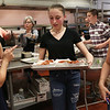 Staff photo/ HADLEY GREEN<br /> Seventh grader Emma Croke carries pasta dishes out of the kitchen at Swampscott Middle School's charity dinner to support Feeding America. <br /> <br /> 06/12/2018