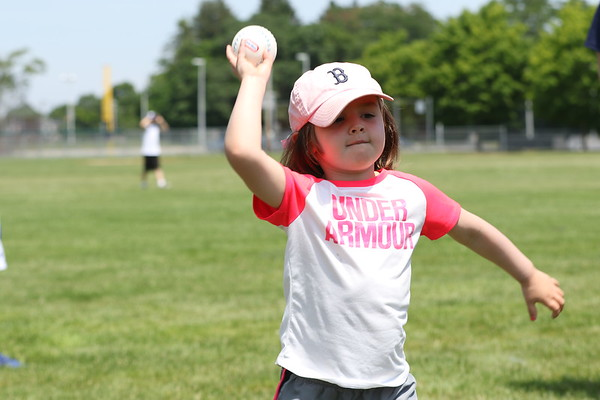 HADLEY GREEN/Staff photo<br /> Maggie Kulakowski, 4, of Danvers, practices her pitch at Red Sox Day at Plains Park in Danvers.<br /> <br /> 06/30/2018