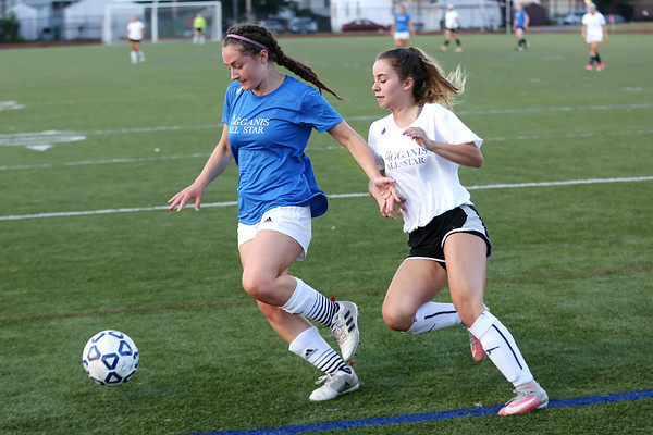 Staff photo/ HADLEY GREEN<br /> North's Apphia Donoghue (15) of Triton keeps possession of the ball at the Agganis girls soccer all-star game.<br /> <br /> 06/26/2018