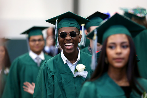 Staff photo/ HADLEY GREEN Students smile as they walk into the Read Gymnasium for the Salem Academy Charter School graduation ceremony.  06/15/2018