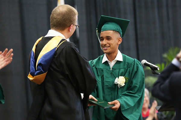 Staff photo/ HADLEY GREEN Jonathan Reinoso receives his diploma at the Salem Academy Charter School graduation ceremony at the Read Gymnasium in Salem.  06/15/2018