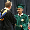 Staff photo/ HADLEY GREEN<br /> Jonathan Reinoso receives his diploma at the Salem Academy Charter School graduation ceremony at the Read Gymnasium in Salem.<br /> <br /> 06/15/2018
