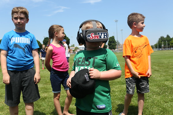 HADLEY GREEN/Staff photo<br /> Ethan Graham, 5, of Danvers, experiences a Red Sox virtual reality story at Red Sox Day at Plains Park in Danvers.<br /> <br /> 06/30/2018