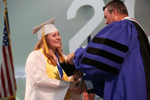 Staff photo/ HADLEY GREEN<br /> Karen Caulfield receives her diploma at the Hamilton-Wenham Regional High School graduation ceremony. <br /> <br /> 06/01/2018