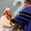 Staff photo/ HADLEY GREEN<br /> Karen Caulfield receives her diploma at the Hamilton-Wenham Regional High School graduation ceremony. <br /> <br /> 06/01/2018