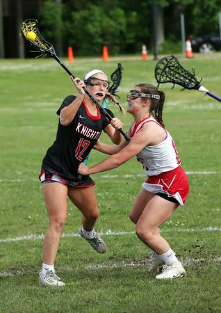 Staff photo/ HADLEY GREEN<br /> North Andover's Dana Swartz (12) moves the ball.<br /> <br /> 06/05/2018