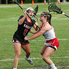 Staff photo/ HADLEY GREEN<br /> North Andover's Dana Swartz (12) moves the ball.<br /> <br /> 06/05/2018