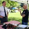 Staff photo/ HADLEY GREEN<br /> Peabody Mayor Ted Bettencourt speaks to Joe Faletra of Buddy Boy BBQ at Peabody's Pop Up Market on the Leather City Common. <br /> <br /> 06/12/2018