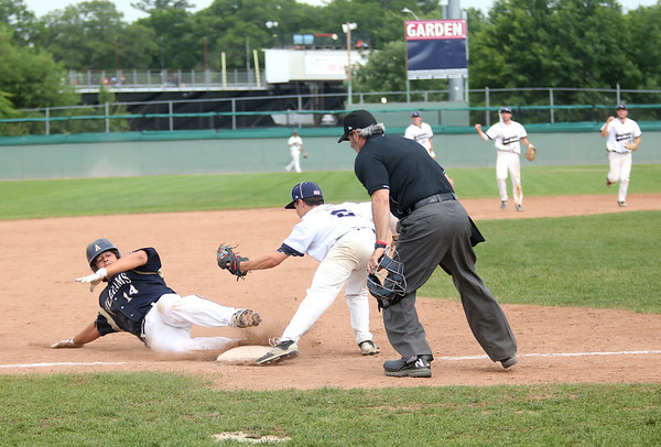 Staff photo/ HADLEY GREEN<br /> Hamilton-Wenham's Cam Vautour (2) gets Archbishop Williams' Ryan Bellew (14) out at third during the Division 4 baseball state semifinals at Campanelli Stadium in Brockton.<br /> <br /> 06/20/2018