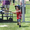 HADLEY GREEN/Staff photo<br /> Colin Page, 6, of Danvers, goes up to bat at Red Sox Day at Plains Park in Danvers.<br /> <br /> 06/30/2018
