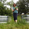 Staff photo/ HADLEY GREEN<br /> Kristen Clay, chair of the garden committee, helps plants peas at the SPUR Community Roots Garden at St. Andrew's Church in Marblehead. <br /> <br /> 06/01/2018