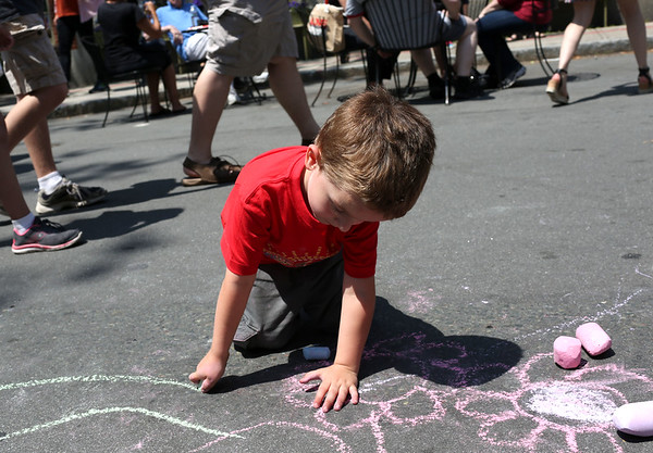 Staff photo/ HADLEY GREEN<br /> Jayce Young, 4, of Marblehead, draws with chalk at the Salem Arts Festival. <br /> <br /> 06/01/2018
