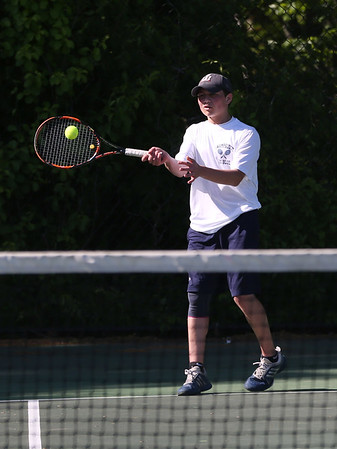 Staff photo/ HADLEY GREEN<br /> Swampscott's Justin Ratner returns the ball during singles play at the Swampscott v. Hamilton-Wenham boys tennis match. <br /> <br /> 05/31/2018
