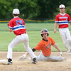 Staff photo/ HADLEY GREEN<br /> Beverly's (10) slides into second base. <br /> <br /> 06/07/2018