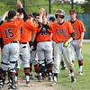 Staff photo/ HADLEY GREEN<br /> Beverly players celebrate after scoring runs in the sixth inning.<br /> <br /> 06/07/2018