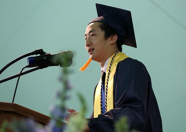 Staff photo/ HADLEY GREEN<br /> Valedictorian Jaeyoung Kim addresses his peers at the Hamilton-Wenham Regional High School graduation ceremony. <br /> <br /> 06/01/2018