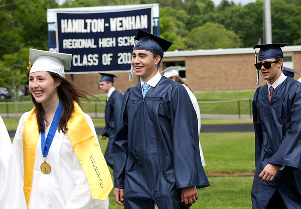 Staff photo/ HADLEY GREEN<br /> Students enter the Hamilton-Wenham Regional High School graduation ceremony. <br /> <br /> 06/01/2018